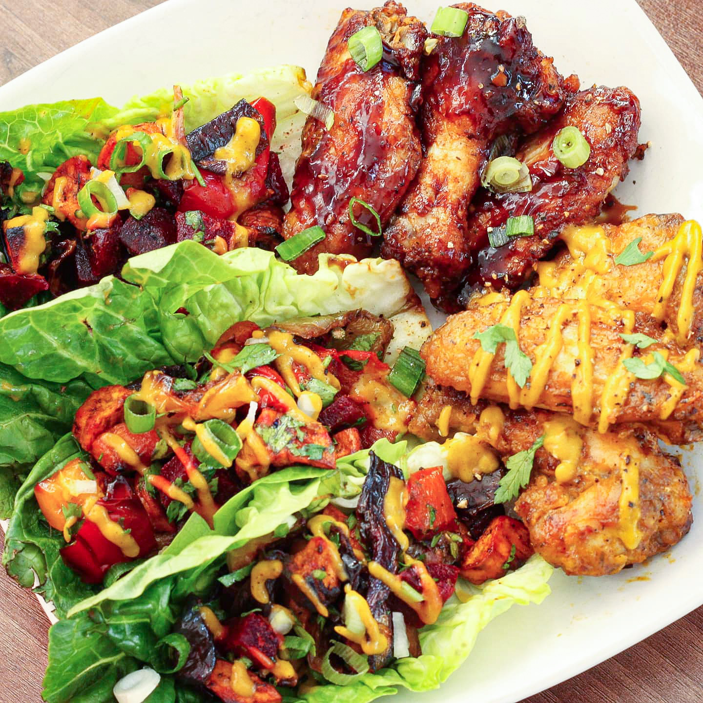 Roasted Vegetable lettuce wraps with mango sauce & Baked wings.