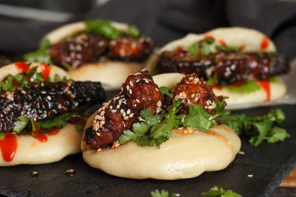 close up chicken bao bun with spicy honey glaze