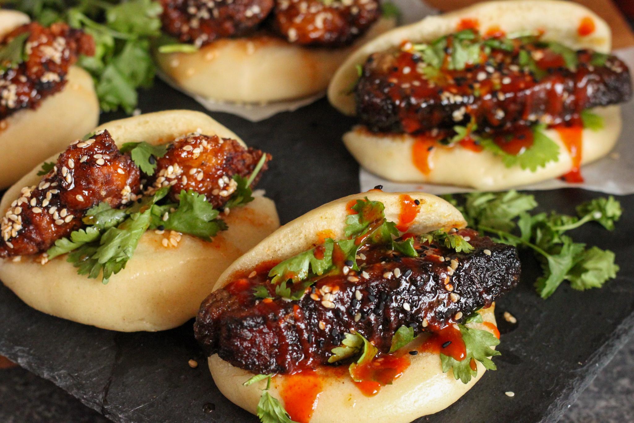 close up pork belly and crispy chicken bao buns